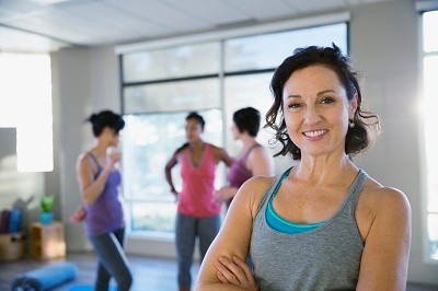 Portrait of smiling woman in yoga classroom