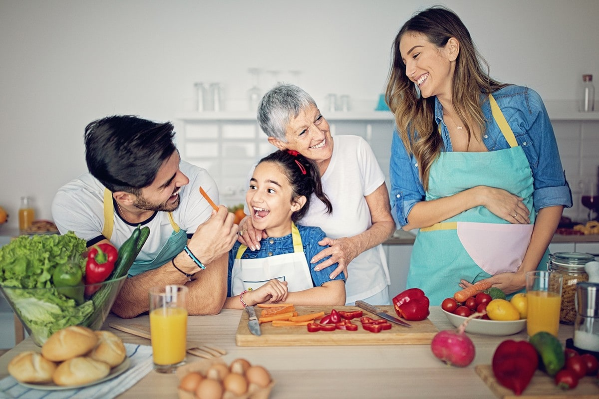Happy family is cooking together in kitchen