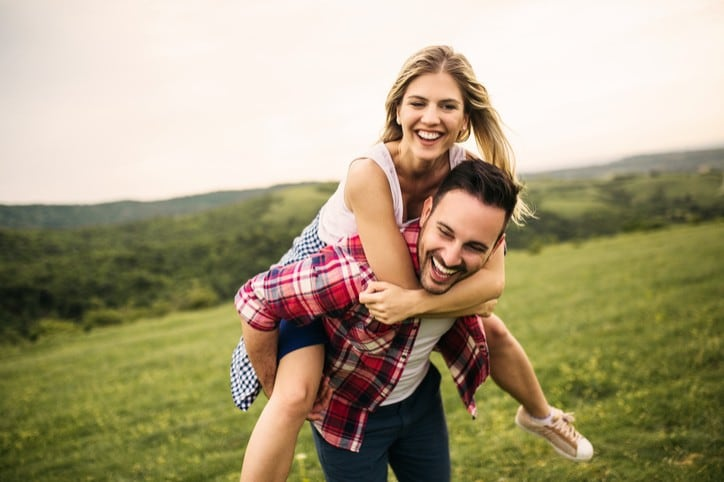 Romantic couple in love having fun outdoor at the empty field